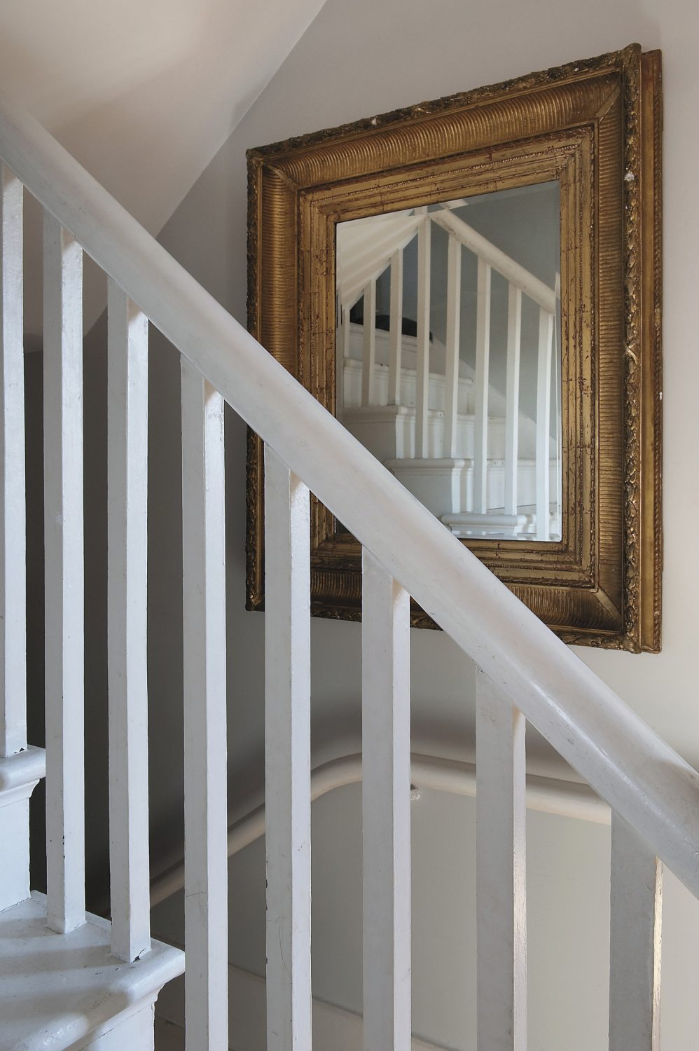 the white-painted staircase