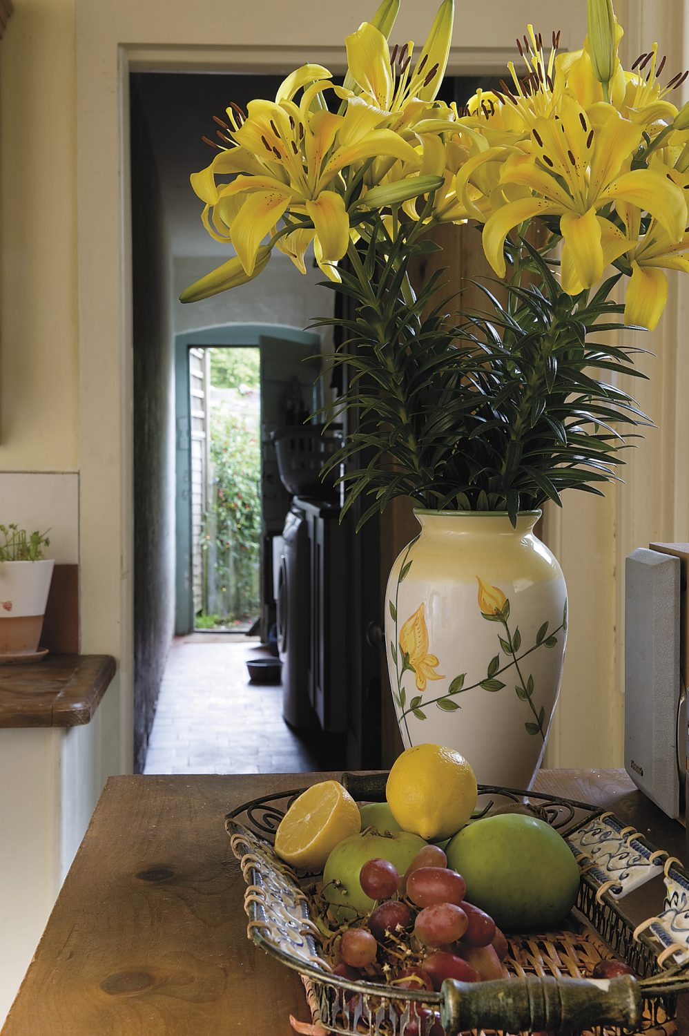 the brick paved passageway leads through the scullery to the garden