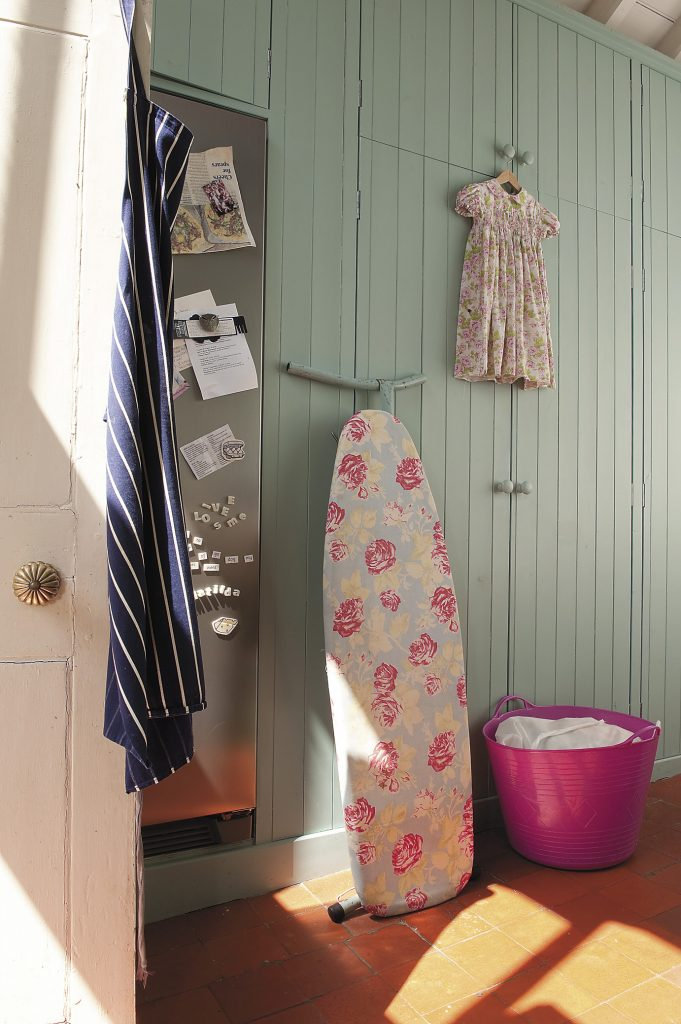 the laundry room is the envy of Katie's London friends, with its high-vaulted ceiling, perfect for drying and ironing the family's clothes