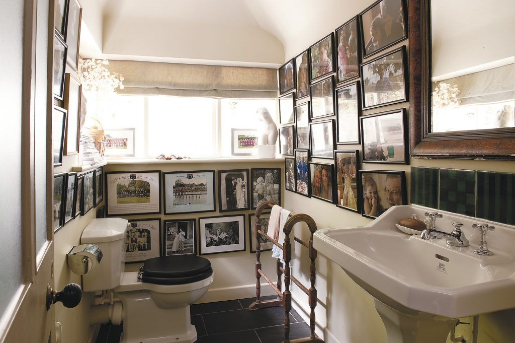 Alex is a keen and talented photographer and the downstairs cloakroom provides the perfect gallery for his family portraits