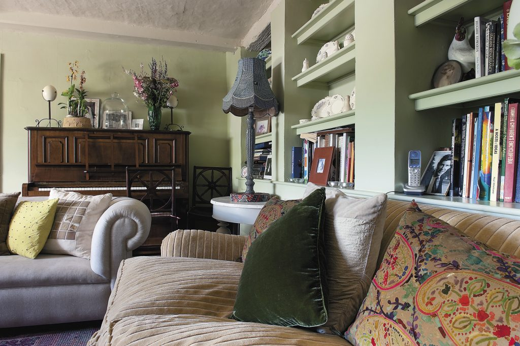 until recently, this cosy sitting room was the dining room; Katie indulges her love of textiles by having them made up into a cornucopia of cushions to cover her ever-expanding collection of seating