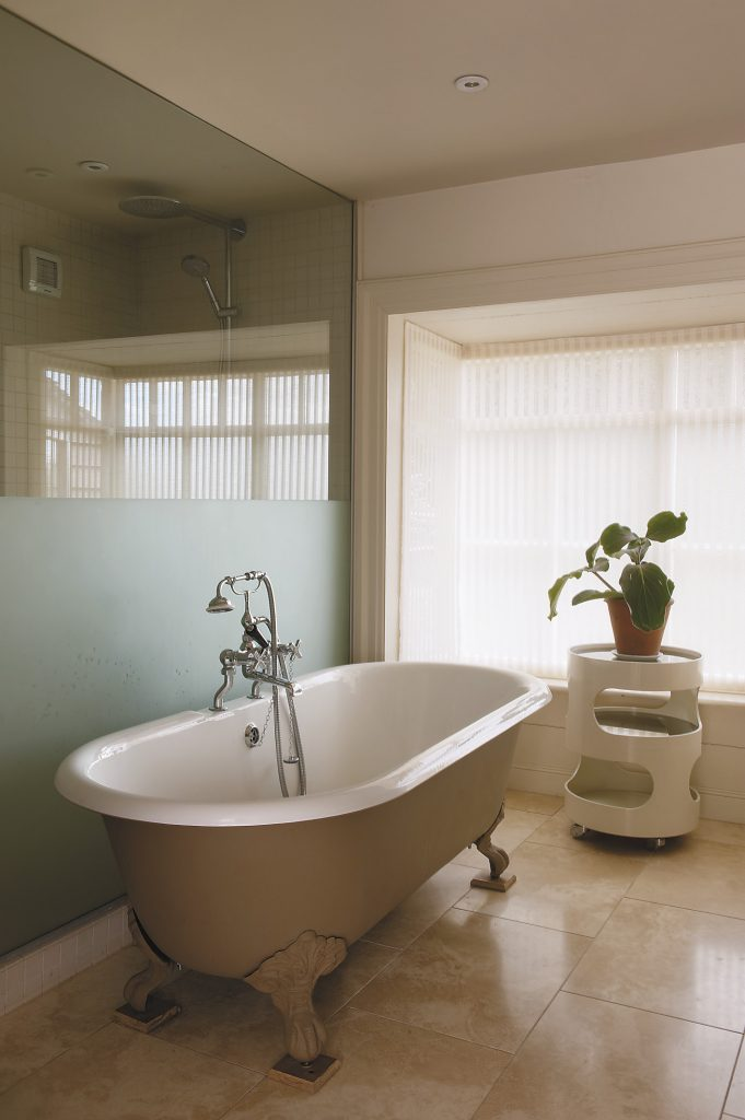 the ensuite master bathroom has been converted from a former bedroom to create a spacious wet room alongside the bateau bath on the Sussex Marble floor