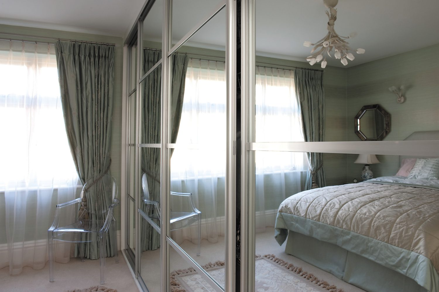 """In the guest bedroom, one wall is comprised of built-in wardrobes with sliding mirrored doors that Jean says were built for them """"in record time"""" by Sliderobes of Aylesford"""