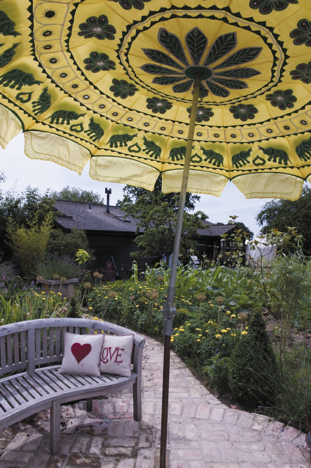 Mel and Lizzie's garden provides many peaceful places in which to relax