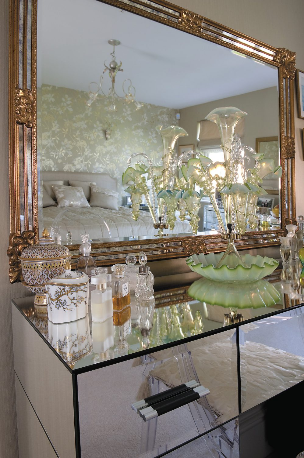 Glass perfume bottles are grouped either side of a glass Victorian epergne