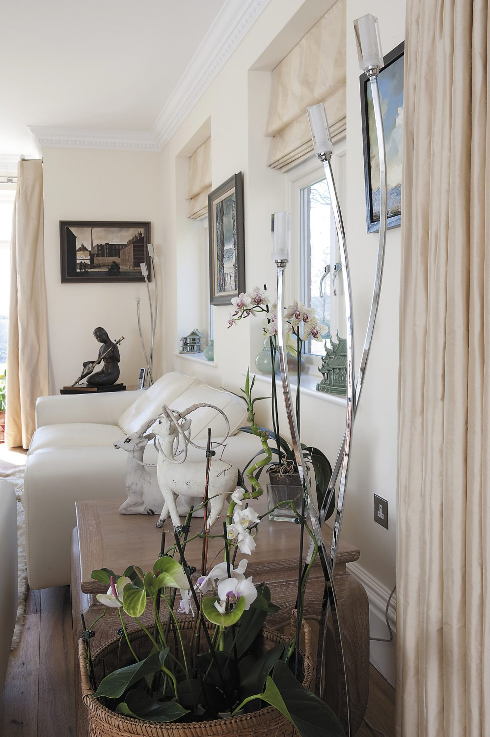 Mike and Jean's apartment has both a contemporary and exotic air and is filled with an assortment of objets d'art that the couple collected whilst living in Thailand