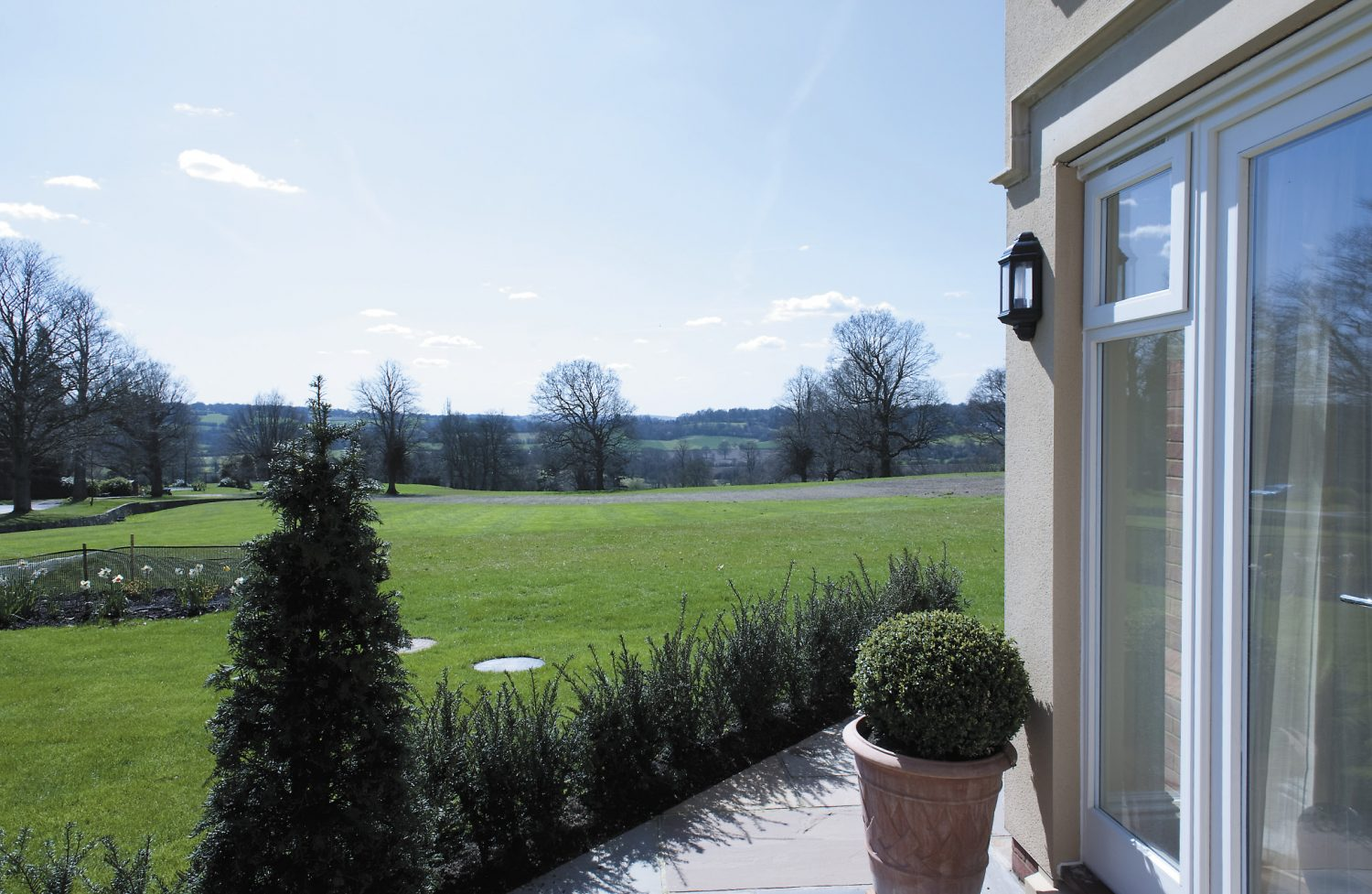 """The apartment enjoys wonderful views across the parkland. """"We have three terraces here so we can change our perspective, or we can walk to the village pub when we have guests, visit Penshurst gardens, or just stroll around the grounds., says Jean"""