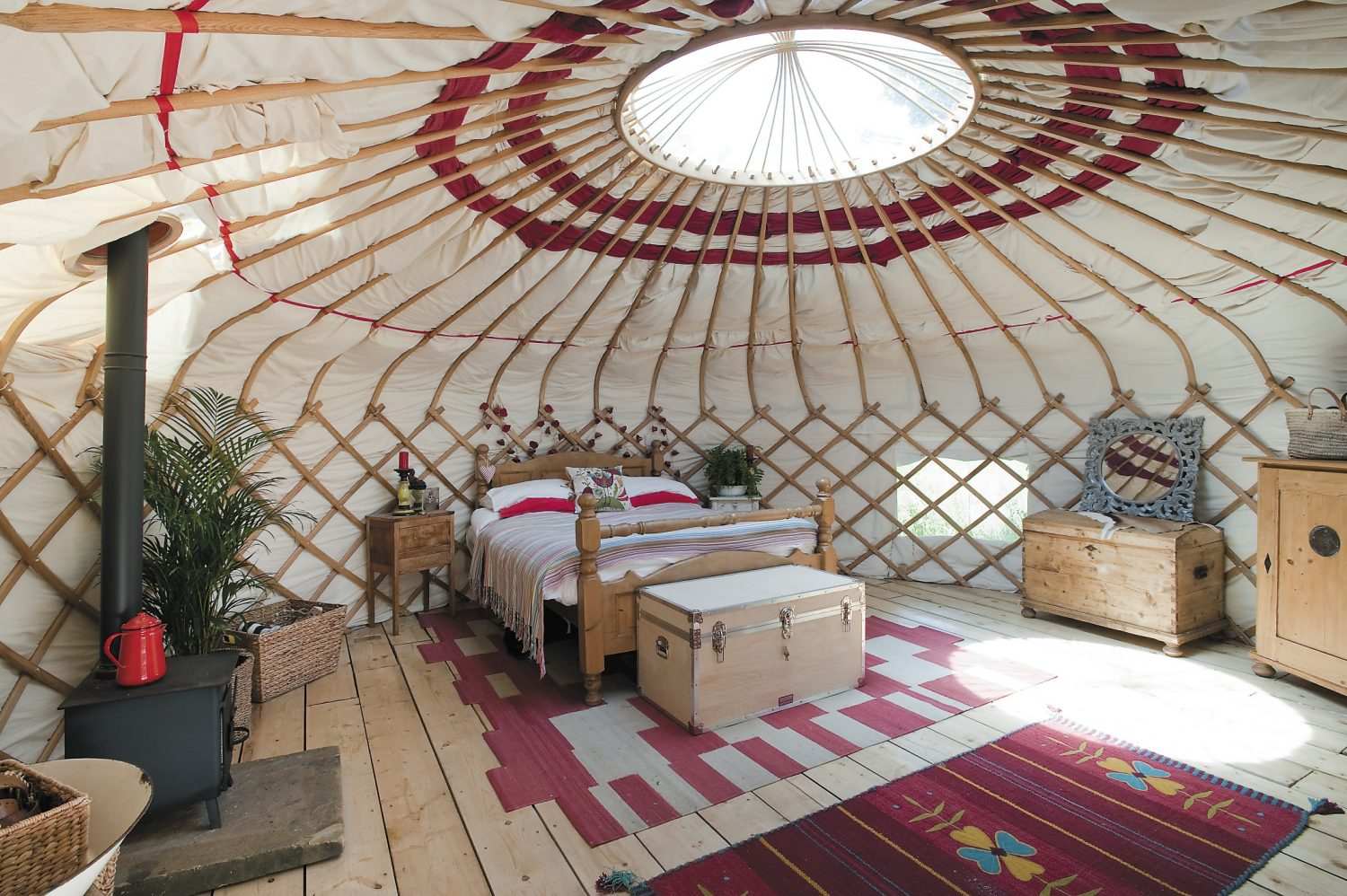 Mel and Lizzie's pièce de résistance is a beautiful yurt that serves as their own wonderful bedroom. A second entrance to Mel and Lizzie's yurt opens onto the garden