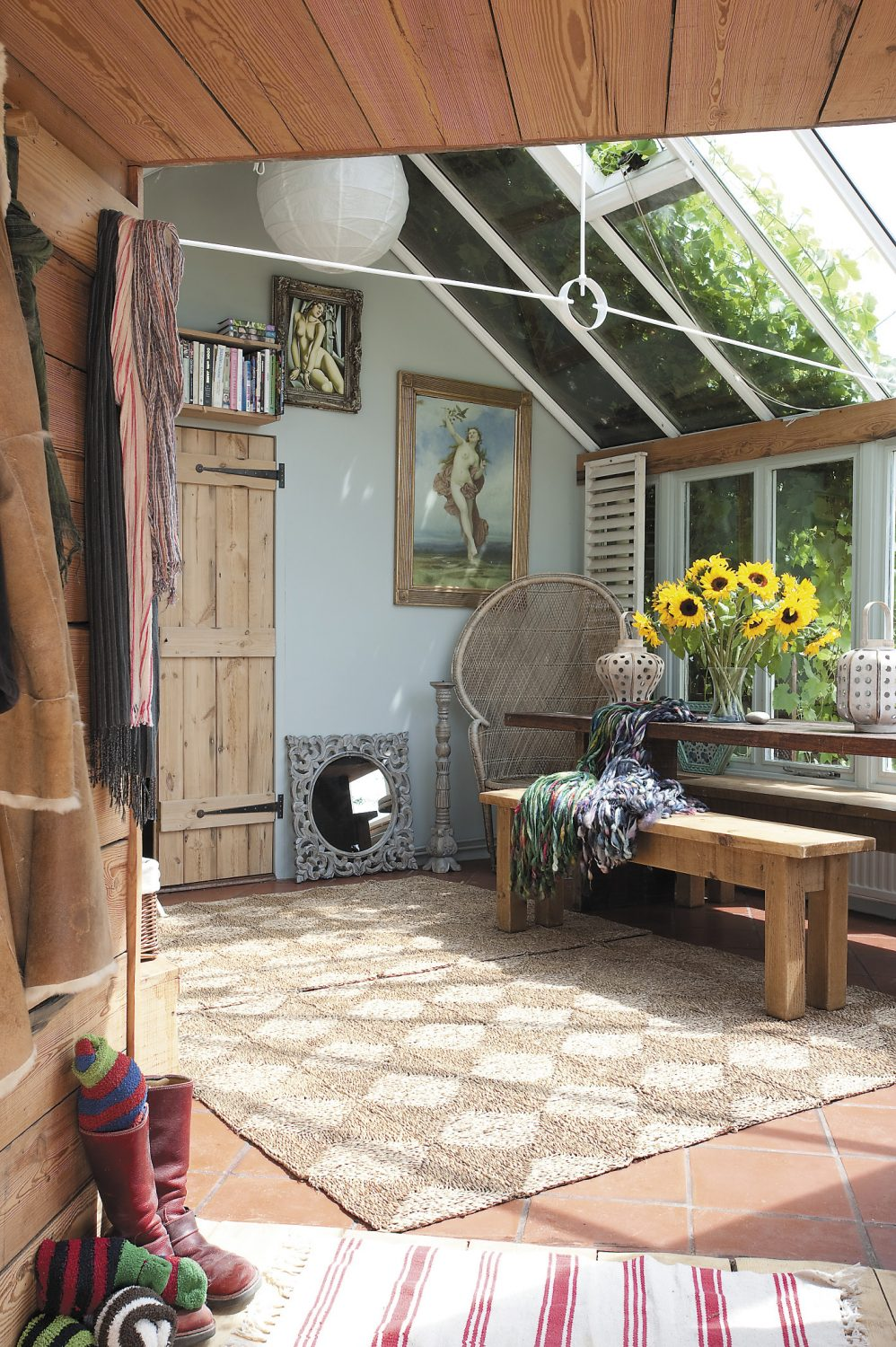 The small passage that connects the yurt to the conservatory is clad in reclaimed timber from Symonds Salvage in Bethersden