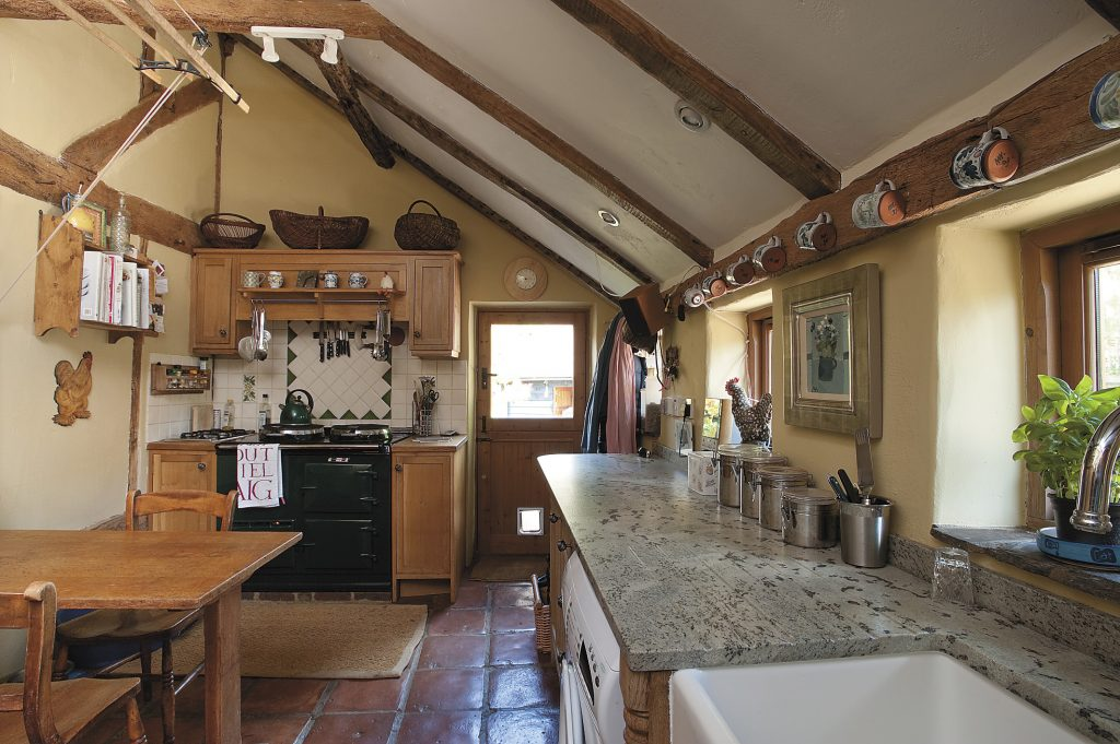 Sophie added extra oak units to the kitchen when she installed the Aga above