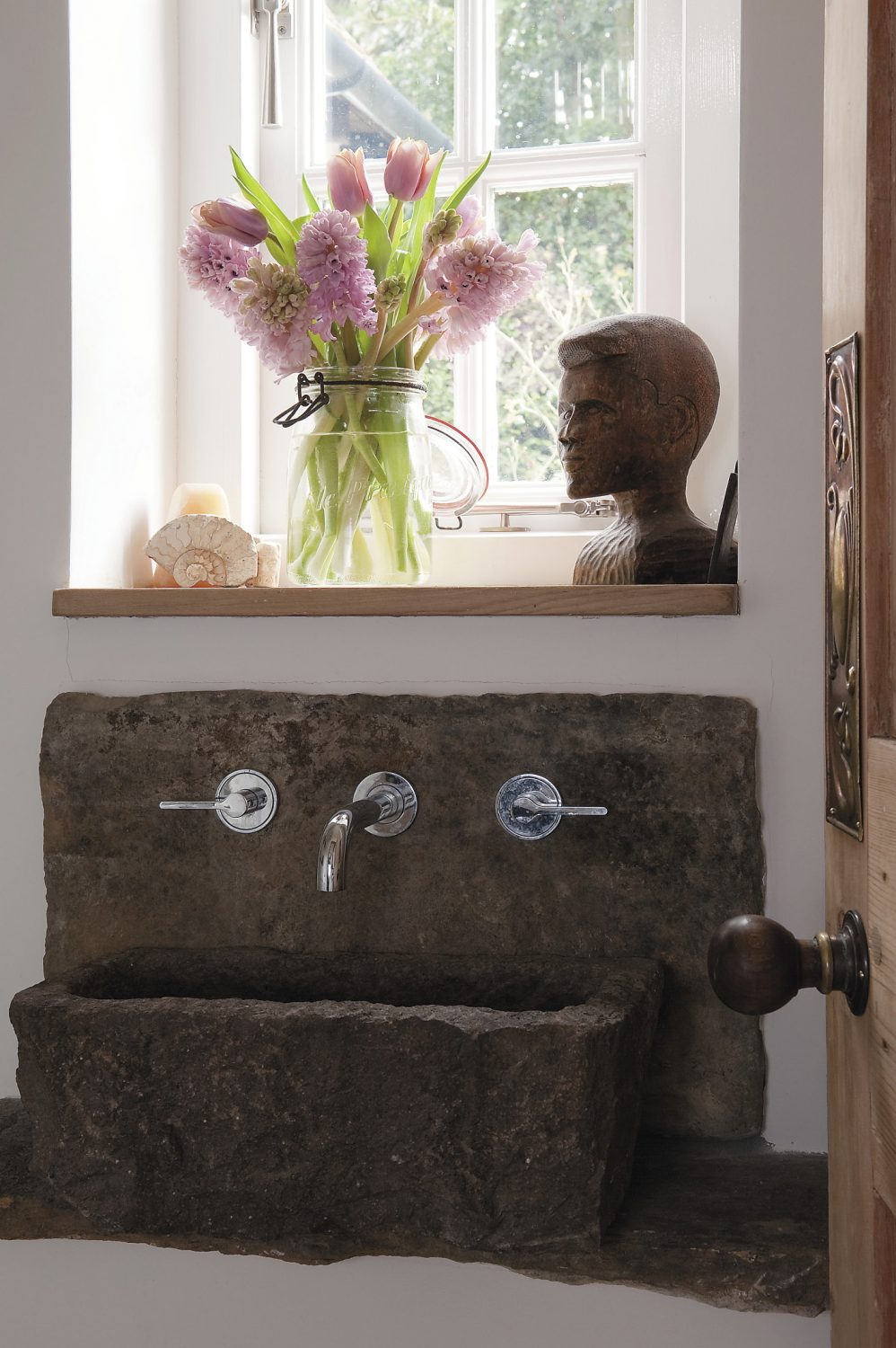 the basin in the downstairs loo was adapted from an old bird feeder