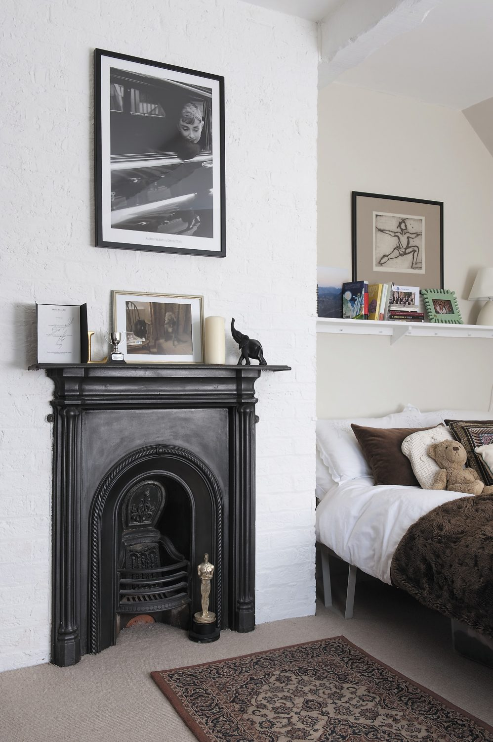 The fireplaces in the bedrooms were probably installed when the oast was converted in 1890
