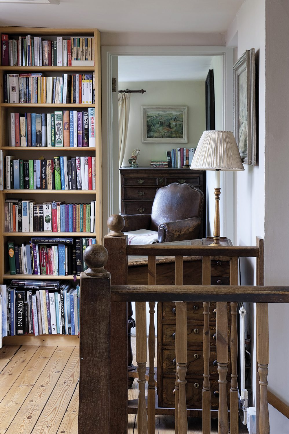 The spacious landing is home to some of Veronica's eclectic collection of books