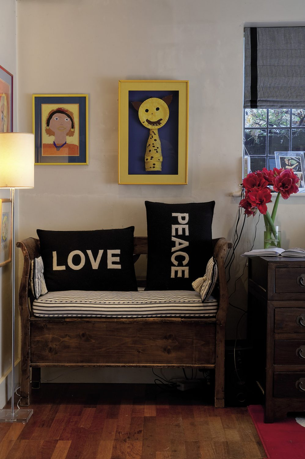 A cosy seating area, just to the side of the kitchen, is home to some of the children's artwork