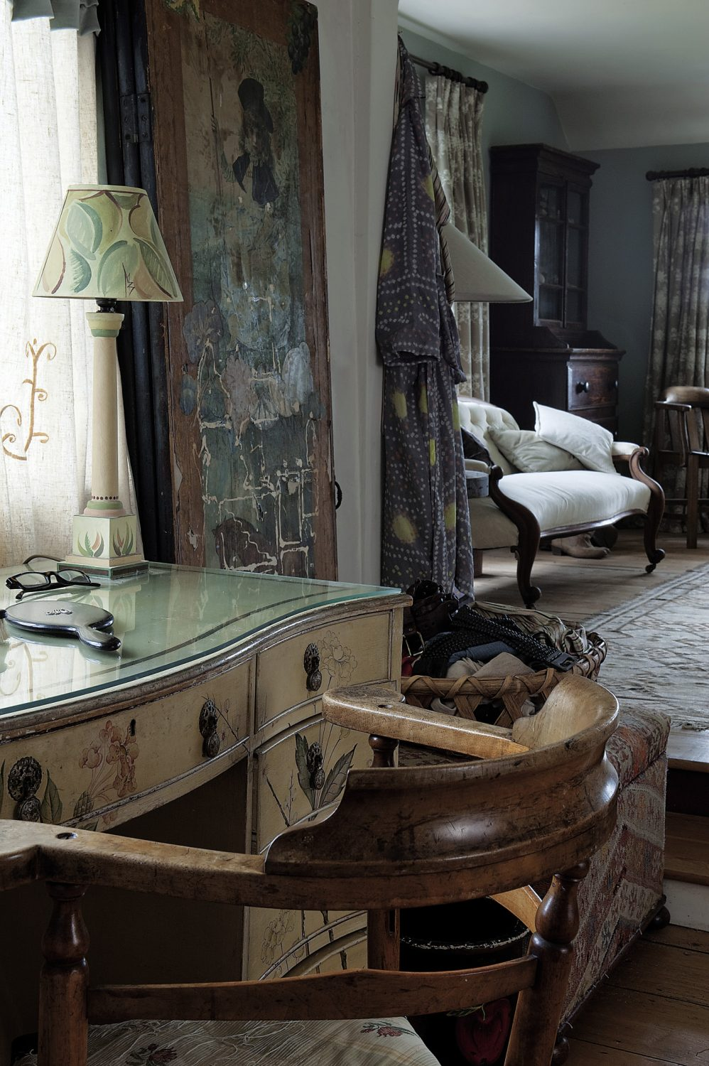 The centrepiece of Veronica's anteroom-cum-dressing-room-cum-office is a terrific, perhaps French dressing table with flower motifs