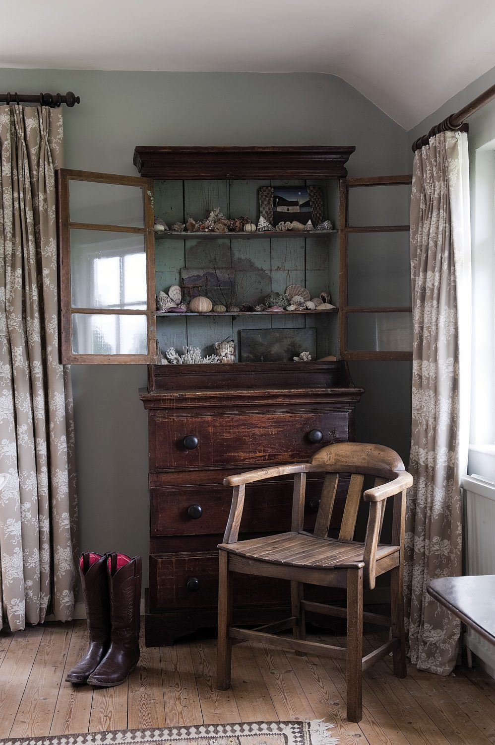 Warmth is provided by natural stripped floorboards and a beautiful little Welsh glass-fronted dresser, home to Veronica's collection of seashells.