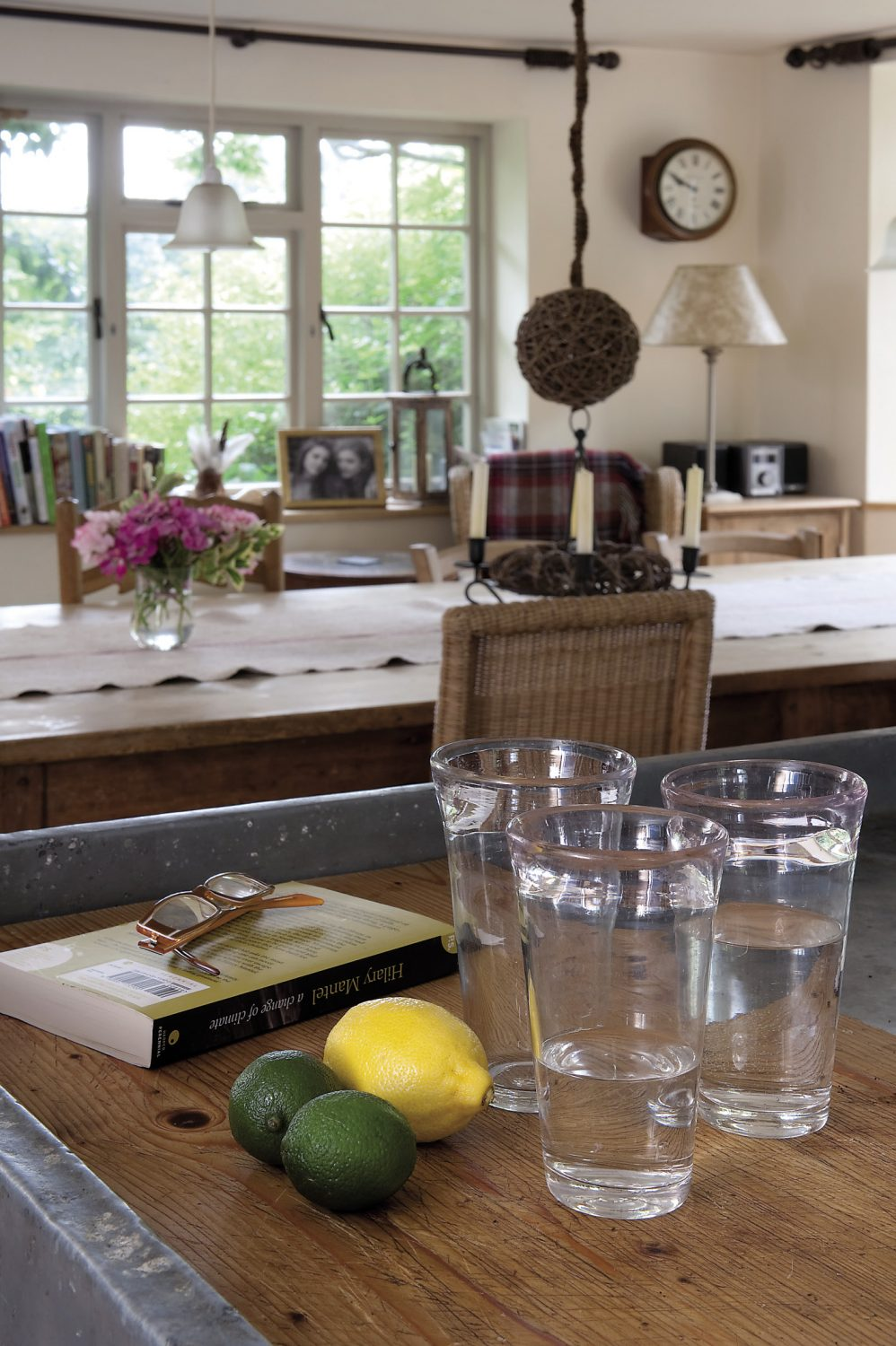 The kitchen has a traditional feel. An old French zinc-topped garden potting table makes a superb six-foot preparation table and a distressed French cupboard stands nearby
