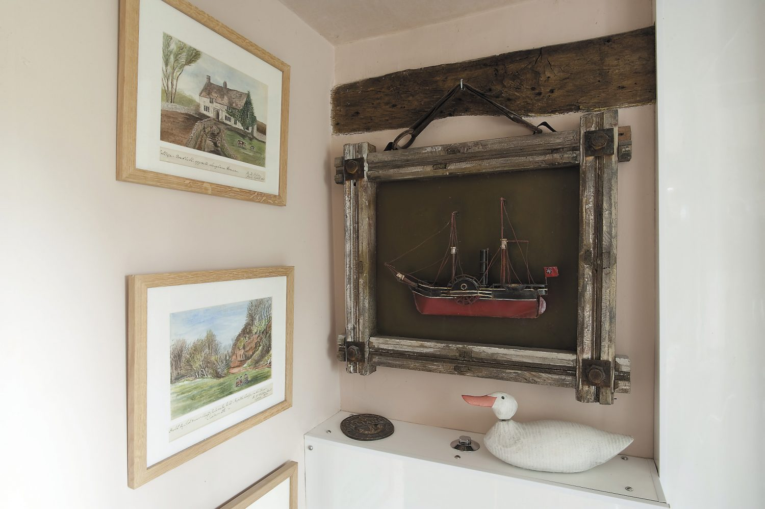 The bathroom. Michael found the naïve watercolours (above left), taken from a Victorian travel journal, at a boot fair for only £1 each; the nautical memorabilia was found locally