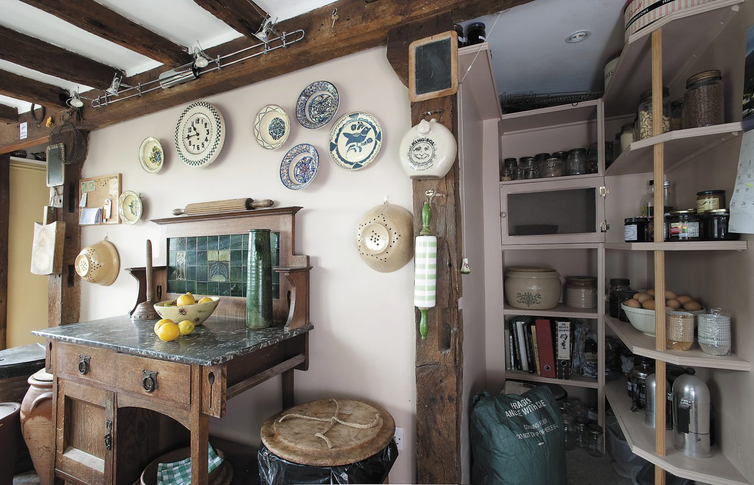Michael moved into the house at 12 noon one August day and within the first half hour removed the breakfast bar, replacing it with an old washstand; the pantry was created out of what is thought to be the site of an old staircase