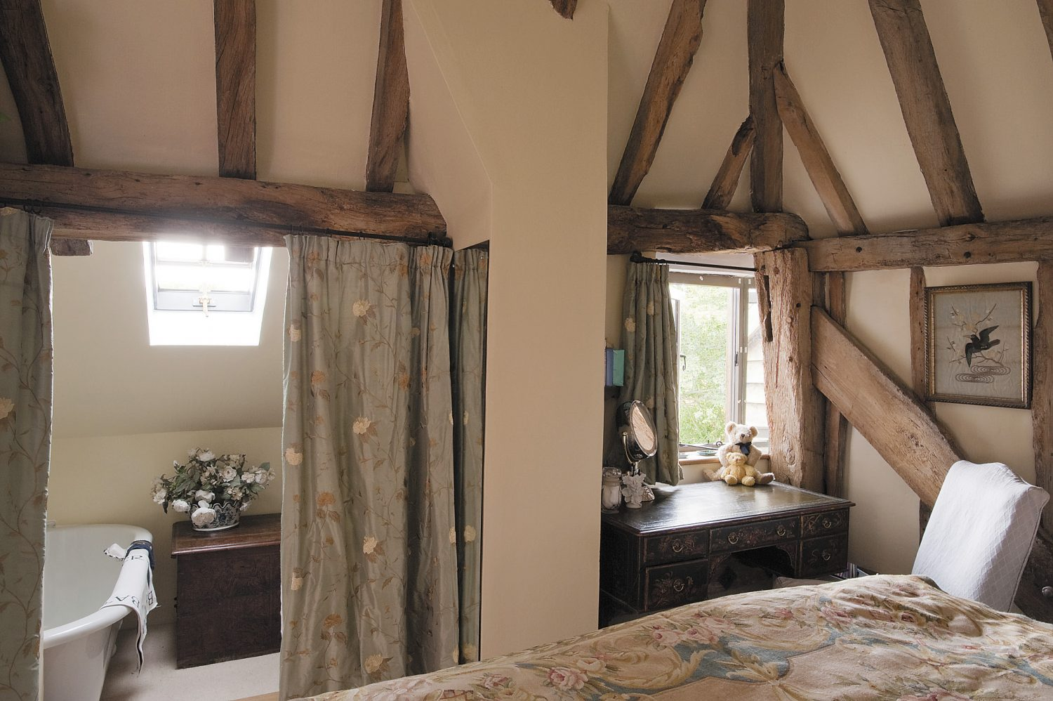 Inside the glass door are the master bedroom and bathroom, the latter virtually built around a magnificent 17th century oak chest