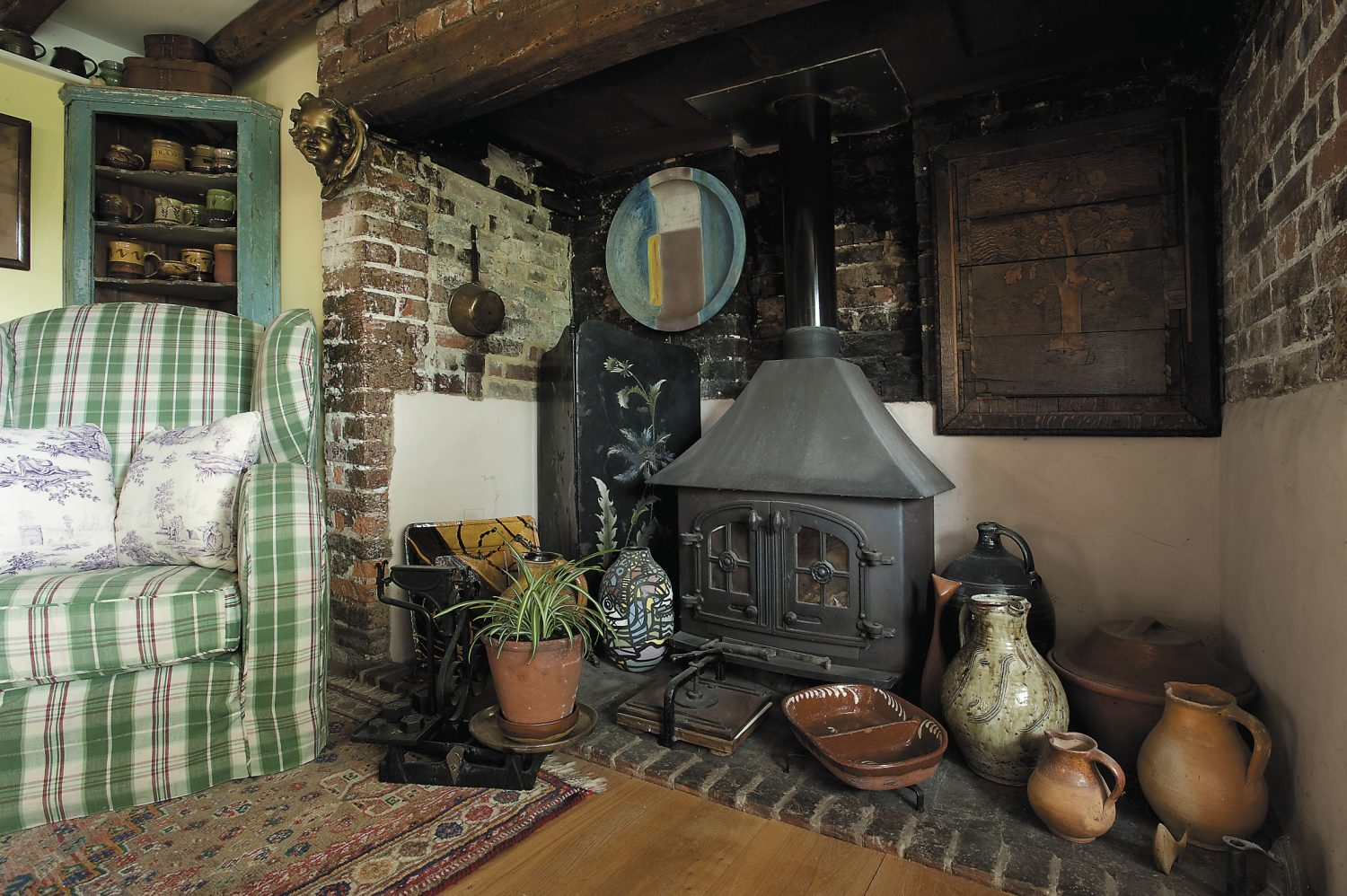 Woodburners have been placed at each end of the living room. They are so efficient that they stay alight from November to January, meaning that the central heating is rarely used
