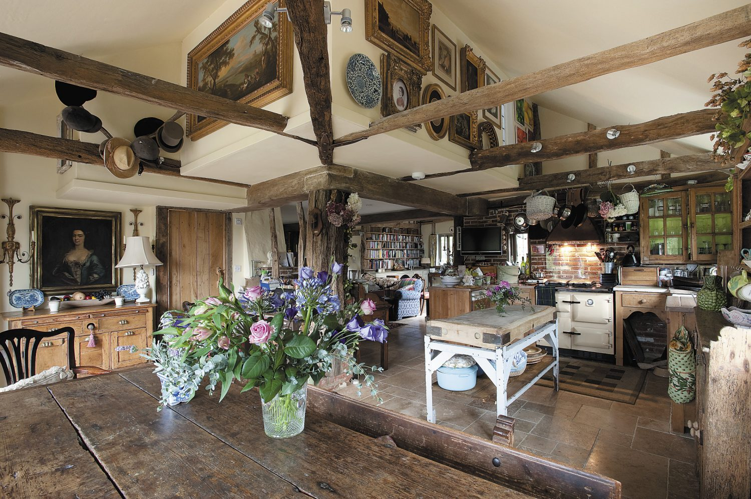 the kitchen has been created from both space which was part of the main barn and from an area which was once little more than a corrugated iron outshot tacked onto the side of the main structure