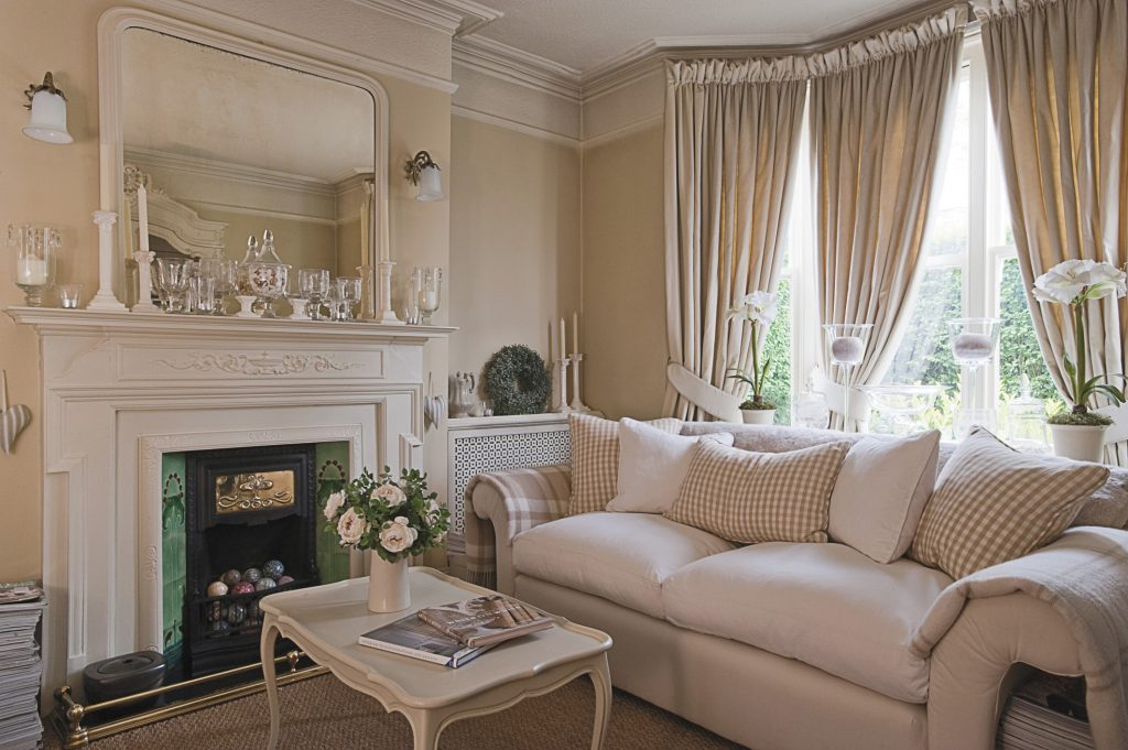 Dee's flair for interior design is strikingly evident in the cosy sitting room: home to a host of beautiful faux flowers, scented candles and a hoard of interior design books