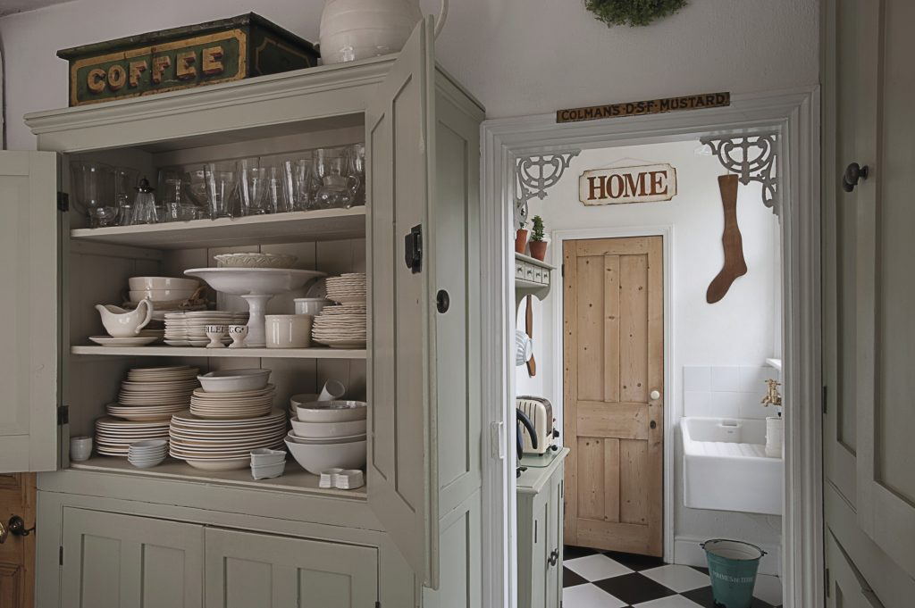 the kitchen and scullery have been left as separate areas. Cupboards and shelves display collections of china and glass
