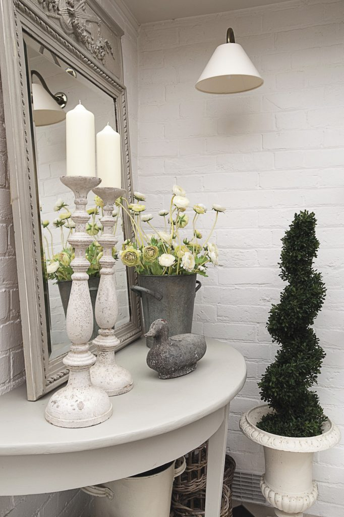 The furniture in the conservatory has been painted in Farrow & Ball's 'Hardwick White'