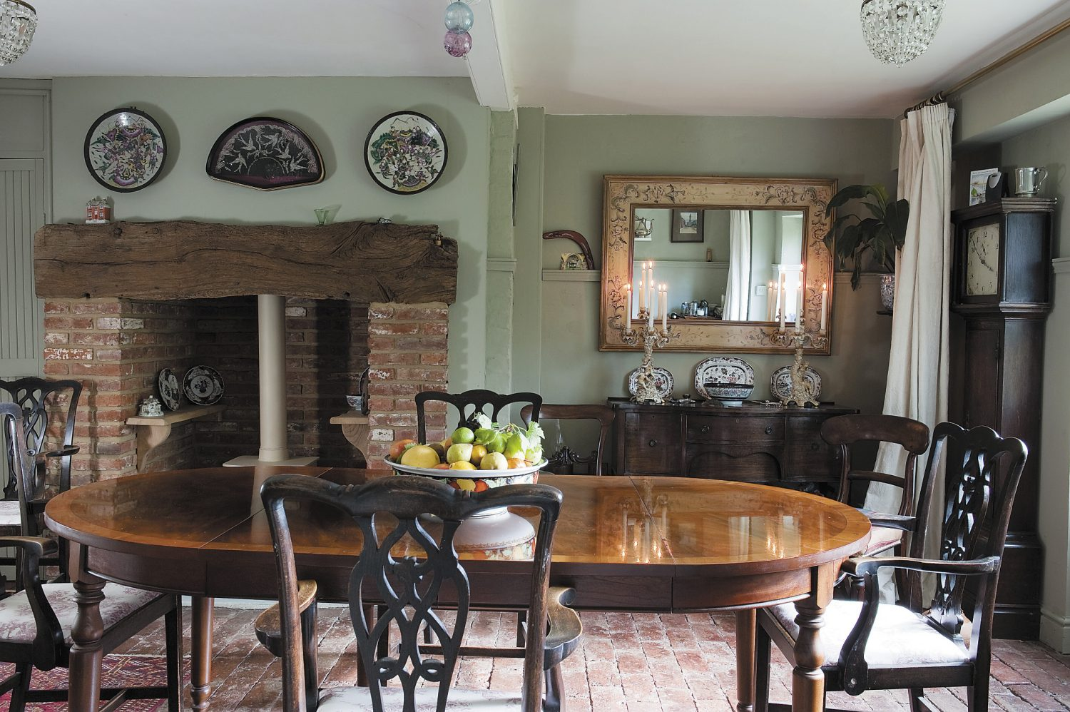 the inglenook in the dining room previously housed an ugly and noisy boiler, now replaced in a more discreet position; with its French doors leading straight out into the garden, the dining room is a bright and sunny room where guests enjoy their breakfast