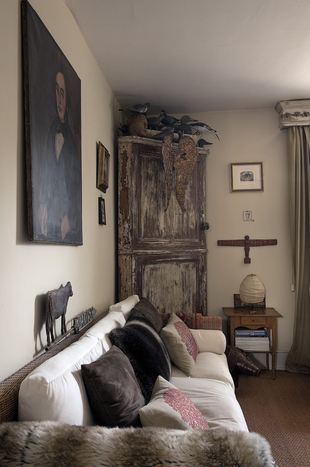 The original sitting room, home to a French corner unit upon which nests a collection of antique shooting decoys