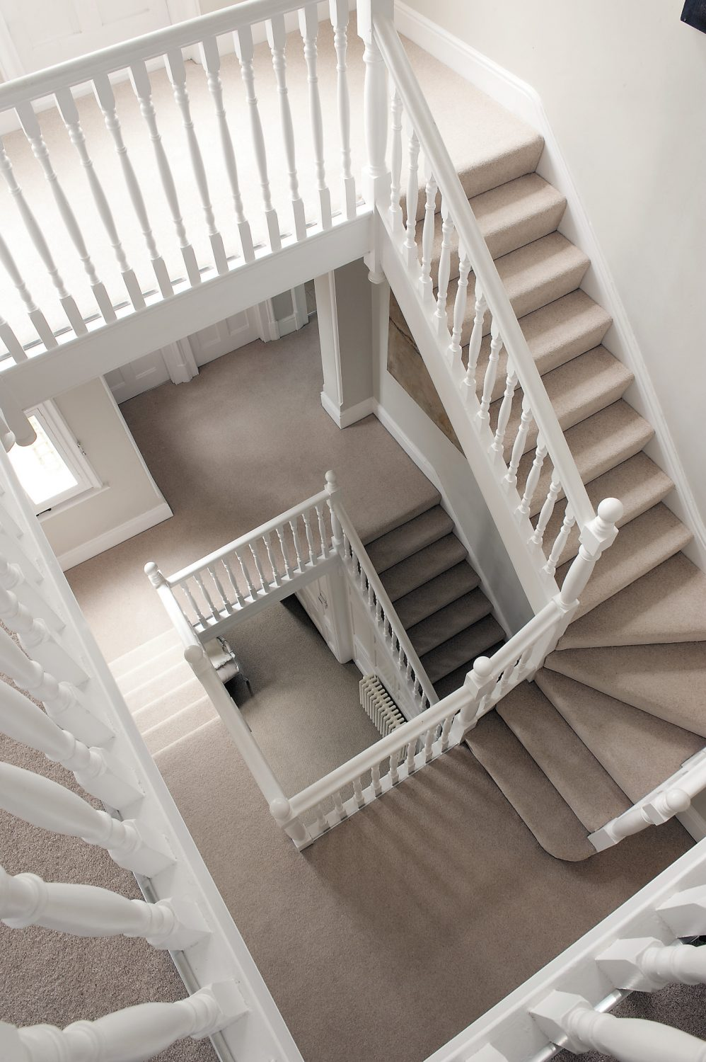 The stunning staircase turns and climbs up three stories round the huge central well.