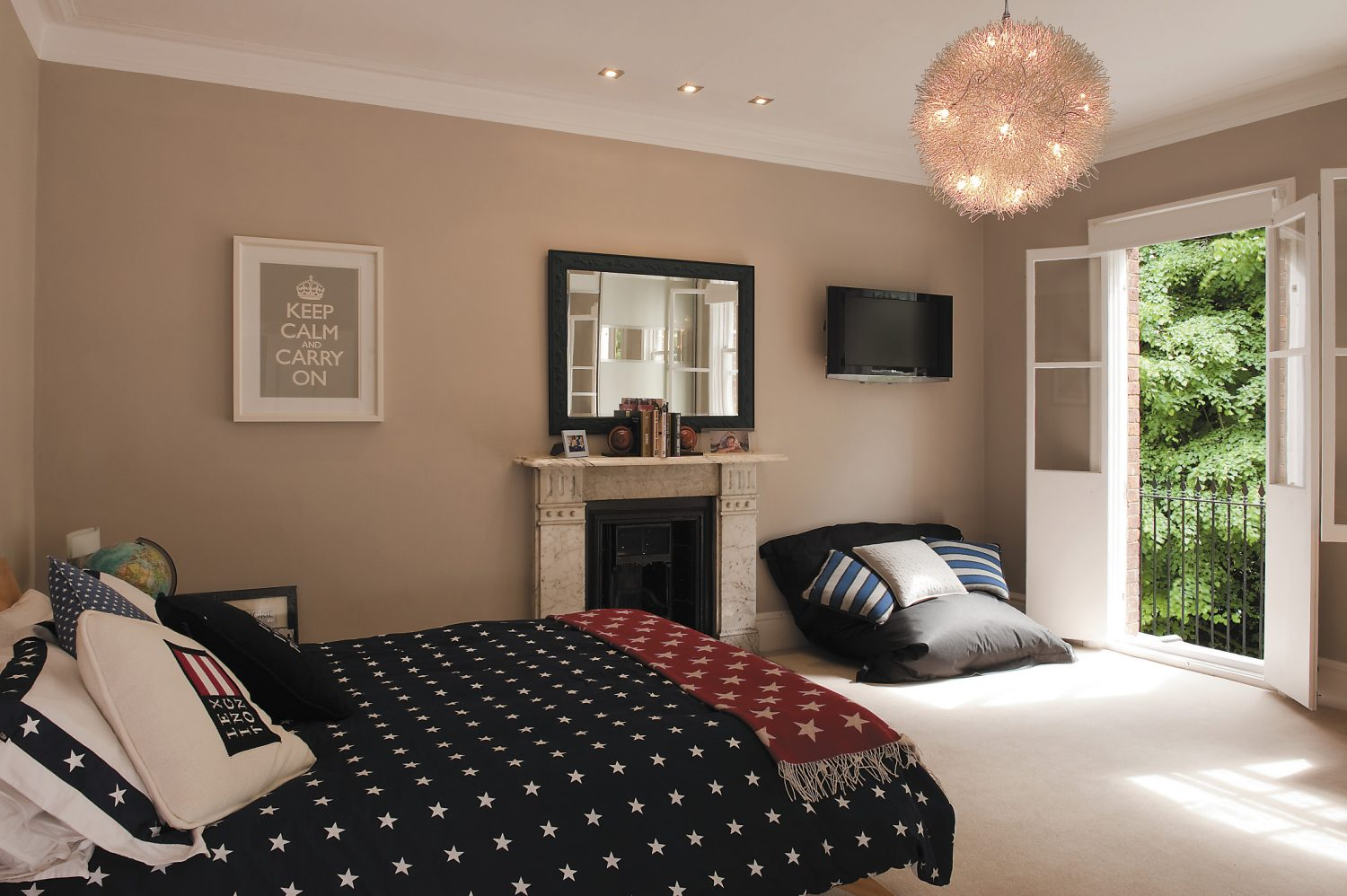 Henrys room is a Gant-fest complete with stars and stripes bedspread. Lighting is by both downlighters – elegant square chrome as elsewhere in the house – and a great fun pendant which looks like nothing so much as a great ball of candy floss being eaten by glowworms