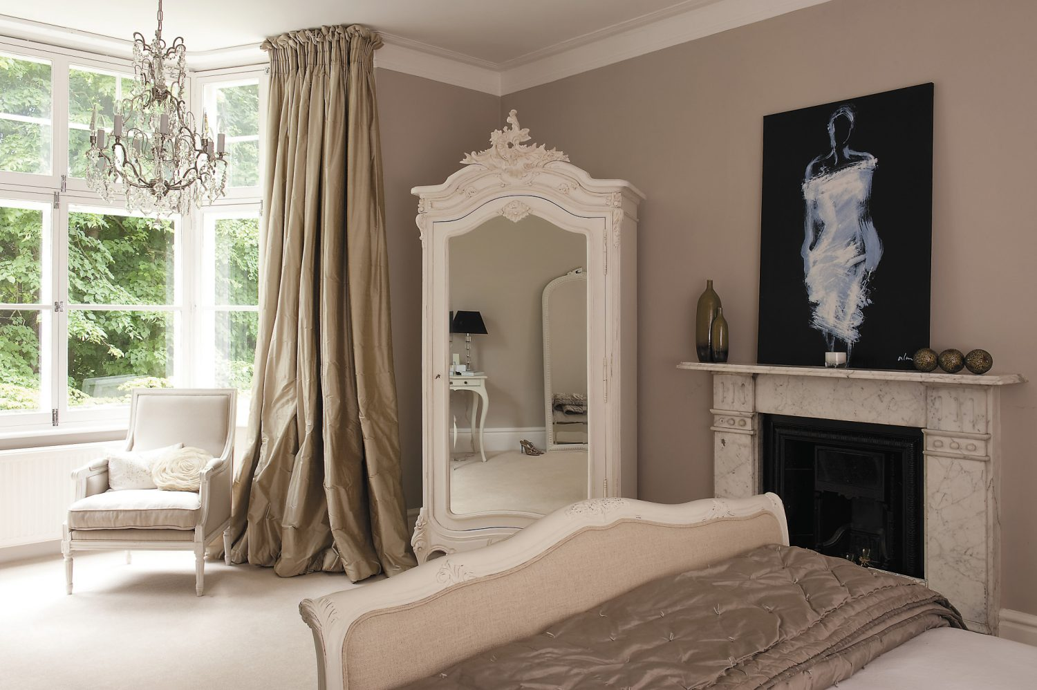 The tranquil master bedroom is painted in Farrow & Ball's 'Elephant's Breath'