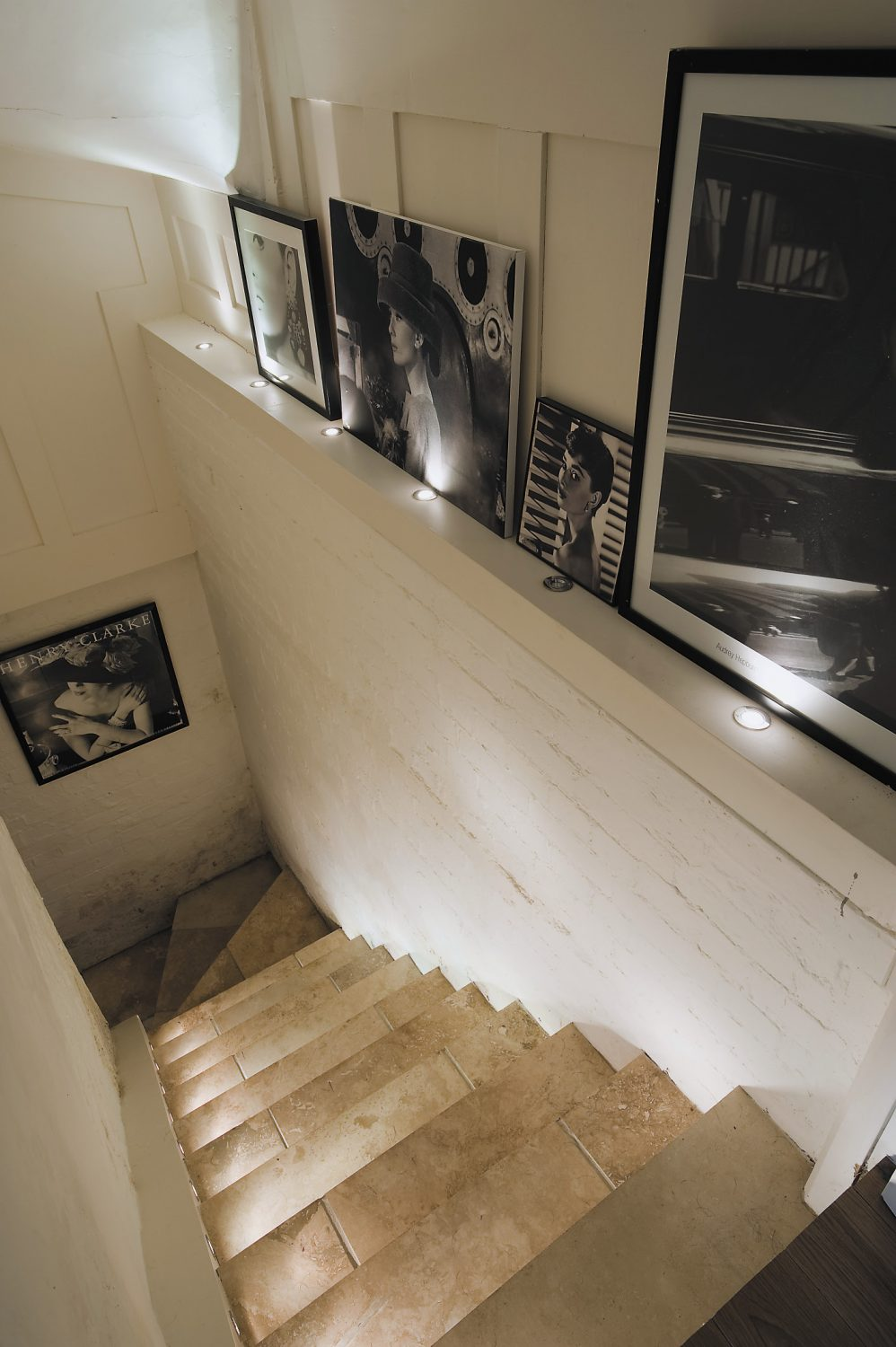 The stairs off the kitchen lead down to the cellar, which doubles as an elegant store for Kenneth's wine and an intimate dining room for late night supper parties