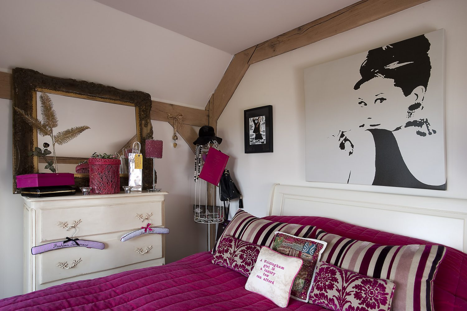 "Daughter Georgie's ""boudoir"" pays homage to Audrey Hepburn in her incarnation as Holly Golightly and has flashes of shocking pink and dramatic black among the otherwise pale French furnishings"