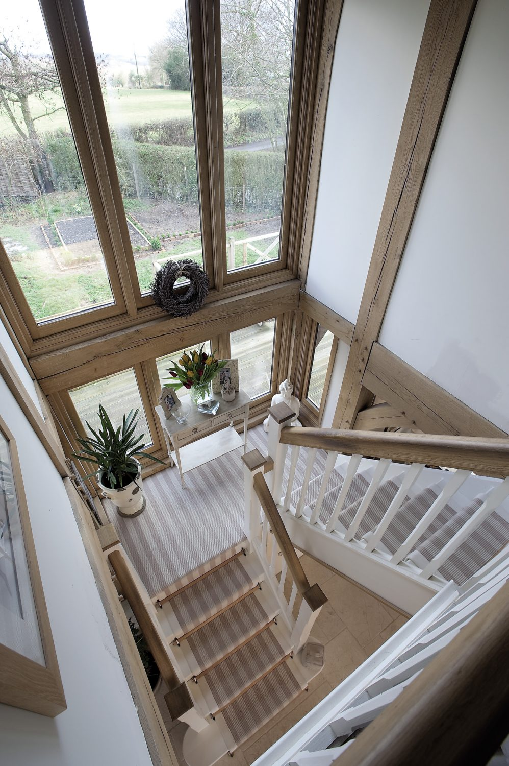 The huge windows frame views of the developing rear garden and provide a wonderful view from the spacious and airy landing