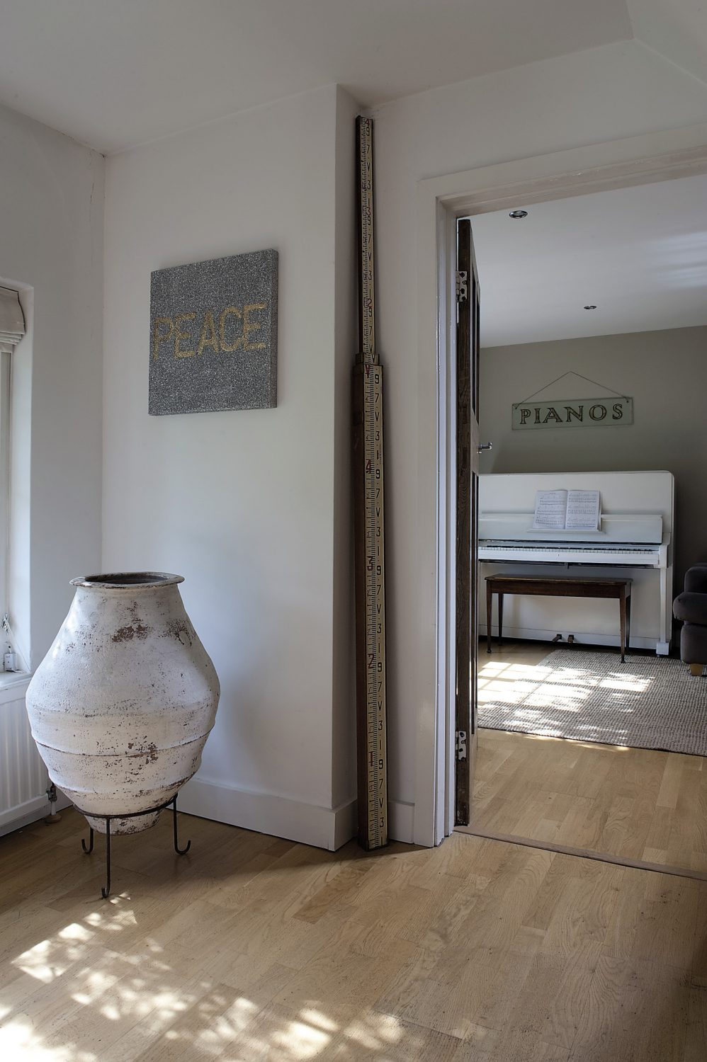 Opposite the sitting room is the music room-cum-playroom where pride of place goes to an upright piano that Sara and Peter have painted white