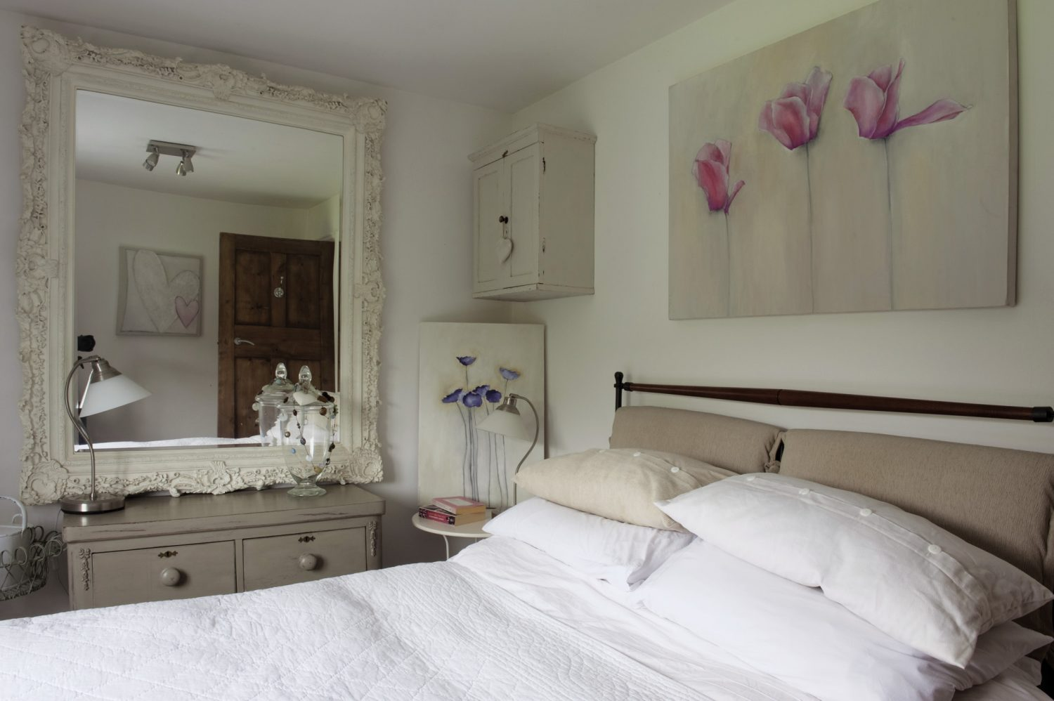 In the pretty guestroom is a fascinating old French, zinc-lined fridge which now serves as a small cupboard