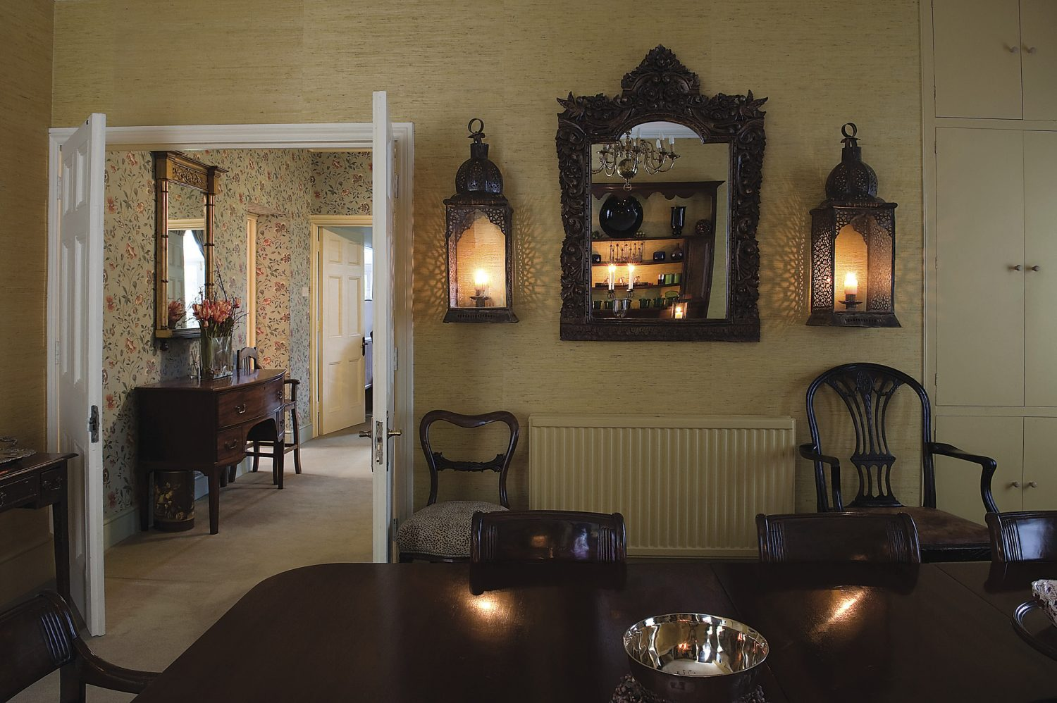 The dining room, decorated with lanterns from Morocco, and a mirror from India. Both were found when Sophie went on buying trips for Liberty