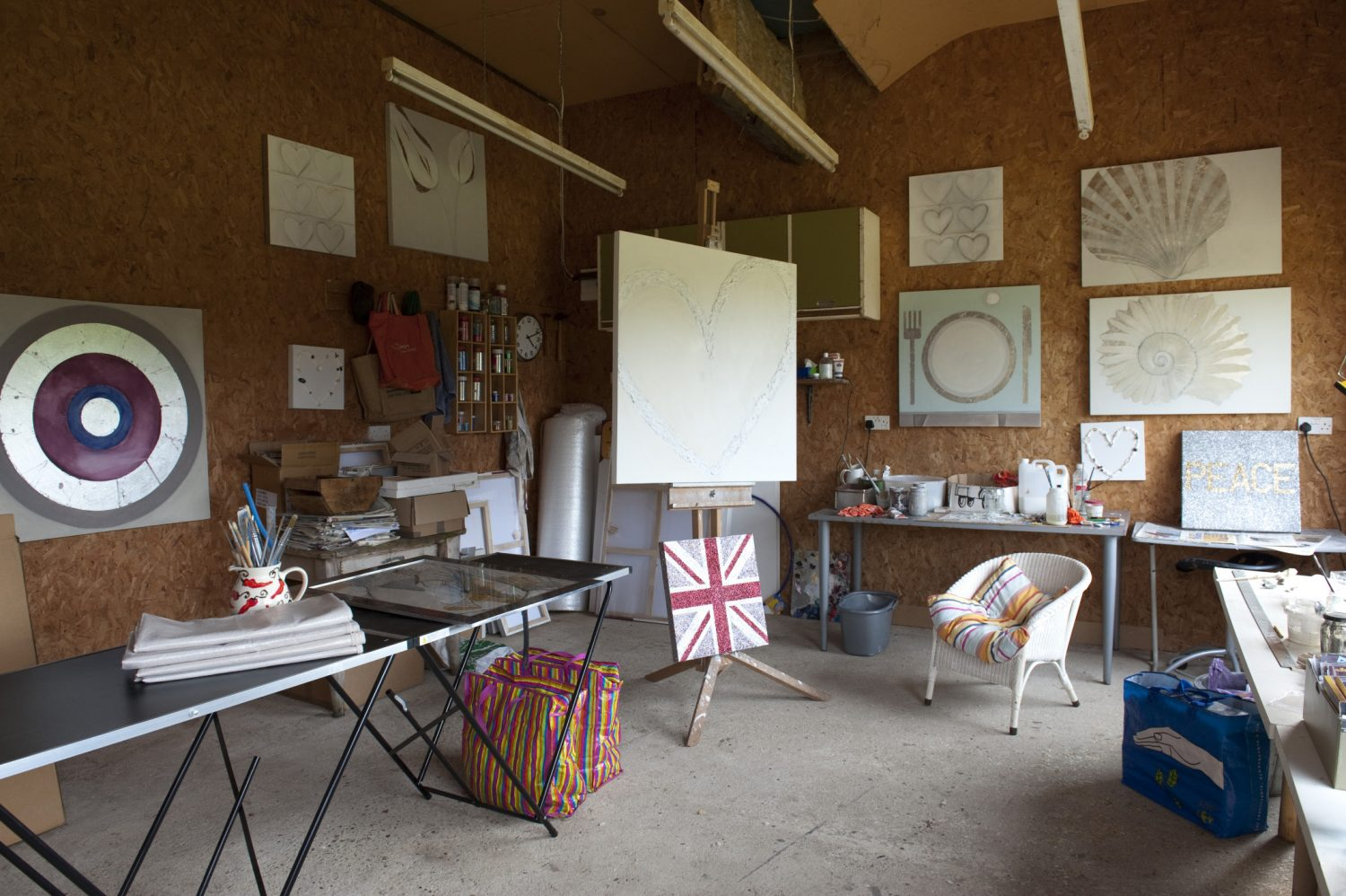 Outside in a neighbouring field and adjoining a working barn is Sara's studio
