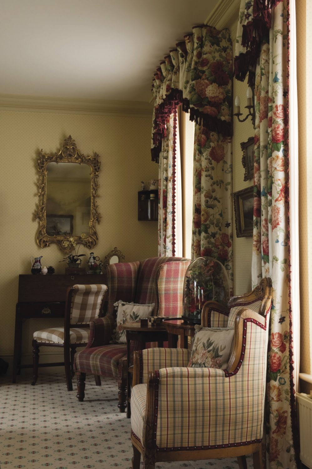 The drawing room is furnished with family pieces, but also items found locally. Sophie had the carpet specially made and then sourced the rest of the fabrics for the sofas and chairs