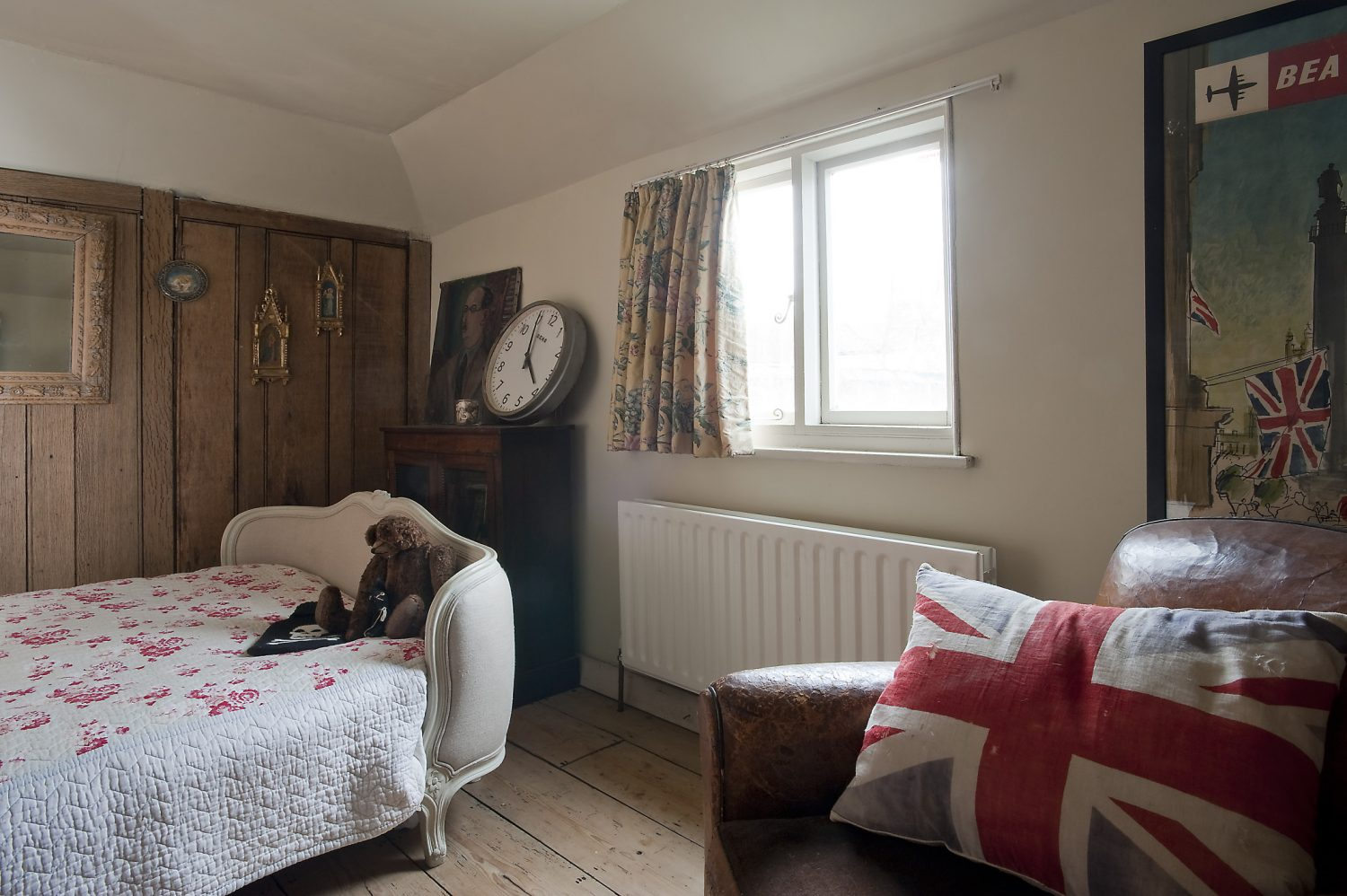 One wall in Martin's room is panelled in oak and although it looks entirely in keeping with the house, Brad says that he installed it and that it was salvaged from the old Stock Exchange in London, an unwanted piece of history when the brokers moved premises