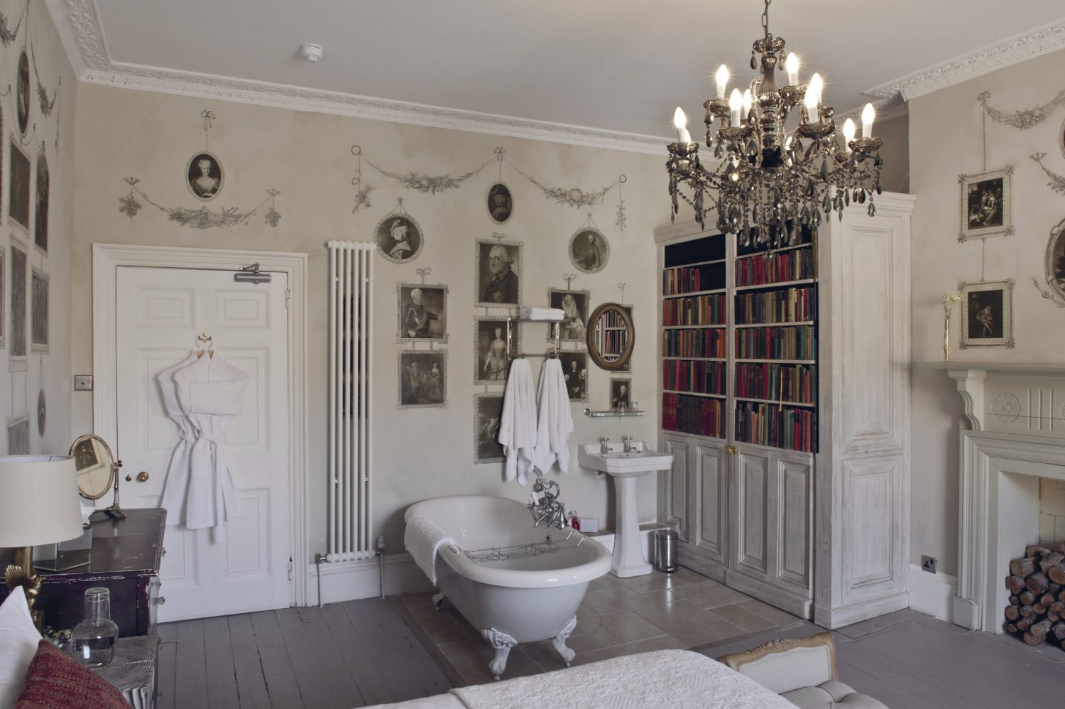 The Old Rectory's Grade II listed status and English Heritage regulations made installing a new bathroom a real challange. To create an en suite for the Crown Room, Lionel fitted the bath in the middle of the room and then cleverly concealed the basin and loo behind a purpose-made bookcase to avoid breaking the cornices up