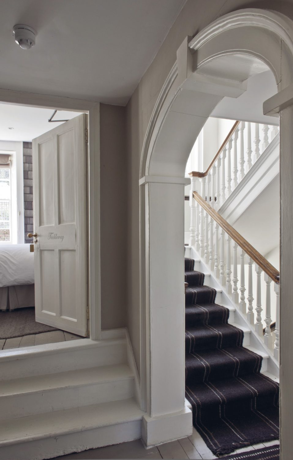 The staircase winds its way up to the guest rooms