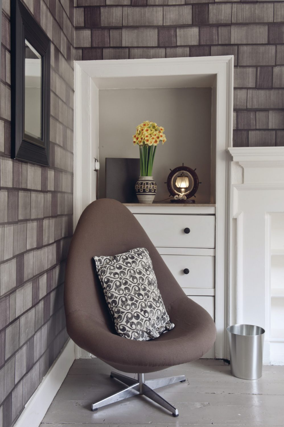 Another nod to the seventies in this room is an egg chair, re-upholstered and with a cushion made up from another Louise Body fabric