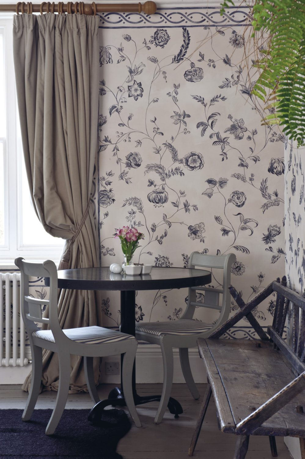 Leading off the reception area is the Breakfast Room where guests can also enjoy an evening meal at the monthly supper club. The walls have been lime washed in off-white upon which local artist Melissa White has hand painted a delft effect pattern of tulips in an interesting blue/grey colourway