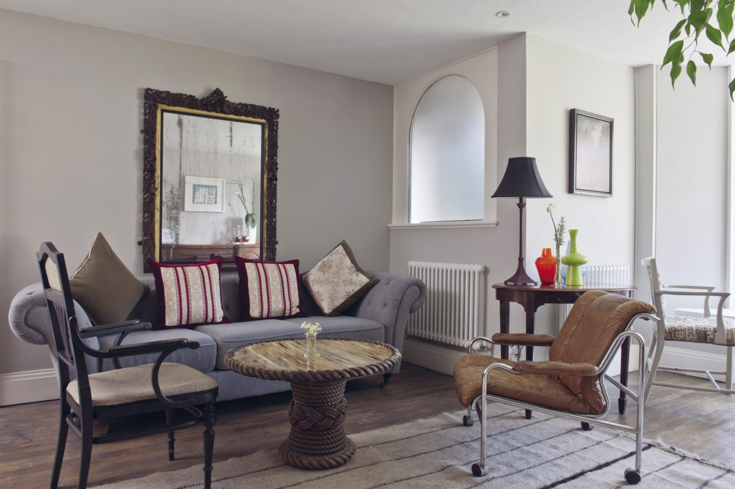One end of the large sitting room is home to an eclectic collection of tables and chairs – some covered in really interesting fabrics from local designer Louise Body – where you can sit and gaze over the Hastings rooftops while enjoying a drink from the bar