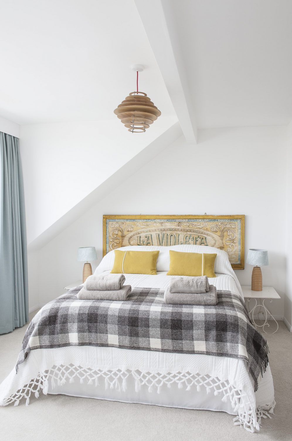 An old fairground sign from France forms a bedstead in the master bedroom
