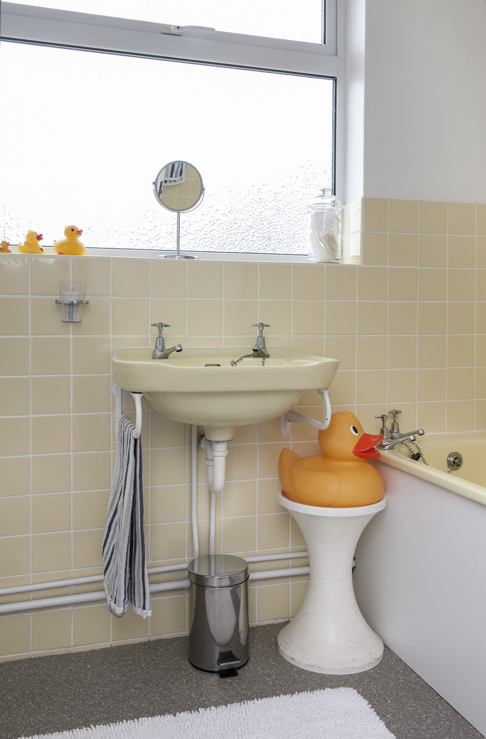 James has retained the original buttermilk-yellow bathroom suite, which is in immaculate condition